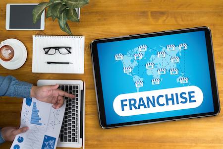 FRANCHISE Businessman working at office desk